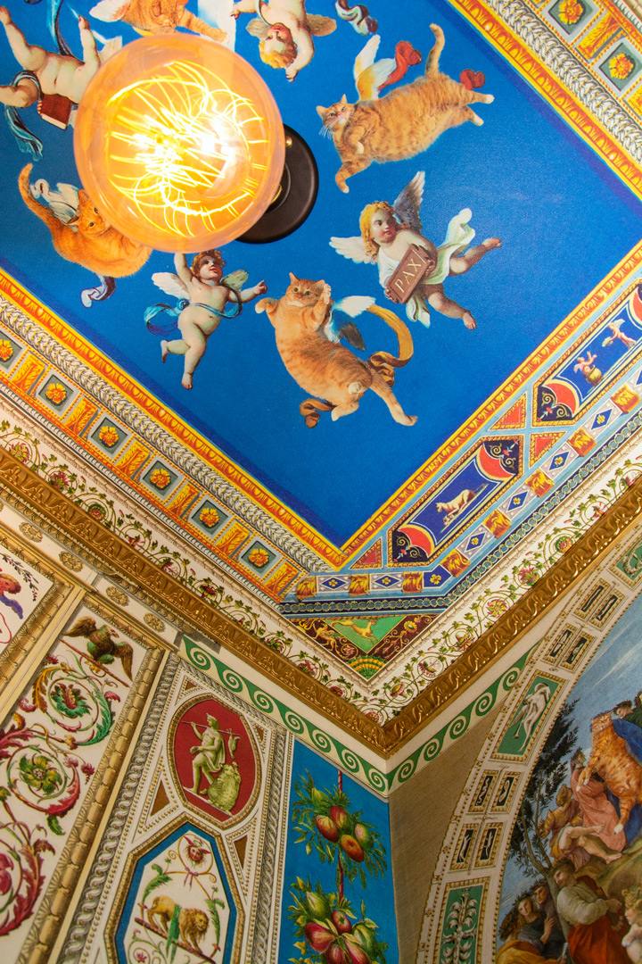 Cats and angels at the ceiling fresco of the secret room in the Vatican museum